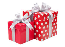 Red boxes gifts tied with gray bows isolated on white Royalty Free Stock Image