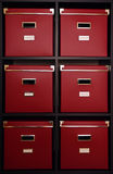 Red boxes on shelf. Six Big archive red boxes on black wooden shelf Stock Image