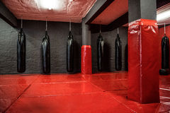 Free Red Boxing Area With Punching Bags Stock Photos - 56495413
