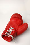 Red boxing glove. A red boxing glove on white ground Royalty Free Stock Photo