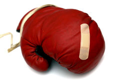 Red boxing glove with band aid Royalty Free Stock Photo