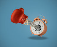 Red boxing glove coming out of alarm clock Royalty Free Stock Images