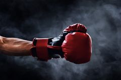 Free Red Boxing Glove On Smoke Backgrounds Royalty Free Stock Photos - 122495738