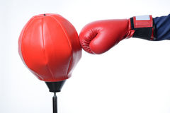 Red boxing glove punch a red punching bag exercises Royalty Free Stock Photos