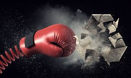 Boxing glove surprise . Mixed media Stock Images