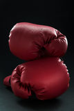 Red boxing gloves on black Royalty Free Stock Images