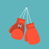 Red boxing gloves hanging on nail of wall. Flat design icon Royalty Free Stock Photos
