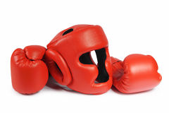 Red boxing-gloves and helmet. (isolated) Royalty Free Stock Photography