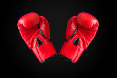 Red boxing gloves isolated on black background, with clipping path Royalty Free Stock Photo