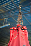 Red Boxing sand bags hanging at gym. Royalty Free Stock Photo