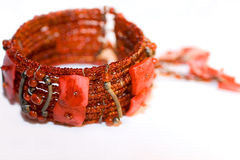 Red bracelet. Red bead bracelet isolated on white royalty free stock photography
