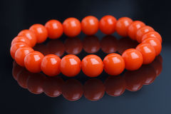 Red bracelet on a black Royalty Free Stock Images
