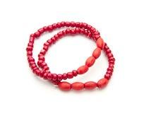 Red bracelet. Children's red braceletes isolated on white background Royalty Free Stock Images