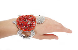Red bracelet in turtle shape on woman hand Royalty Free Stock Photography