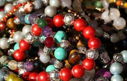 Red bracelets and necklaces  for sale in the jeweler's shop Stock Photos