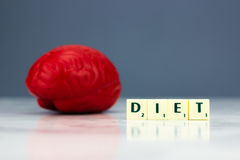 Red brain with diet sign. On dark background Stock Photography