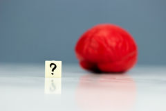 Red brain with question mark. On dark background Royalty Free Stock Photos