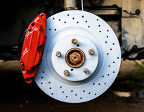 Red brake caliper and disk Royalty Free Stock Image