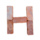 Red brick alphabet font on white background isolated with clipping path.  Stock Image