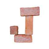 Red brick alphabet font on white background isolated with clipping path.  Stock Photos