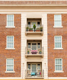 Red brick apartment symmetry. Royalty Free Stock Photo