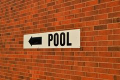 Brick Background With Pool Sign royalty free stock photos