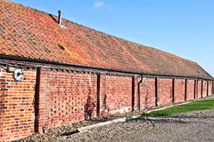 Red brick barn Stock Images
