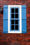 Red brick with blue and white window Royalty Free Stock Photos