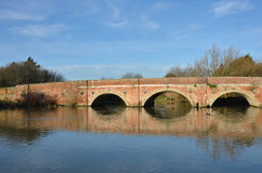 Red brick bridge over river Stock Image