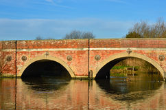 Red brick bridge Stock Images