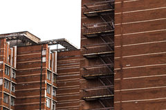 Red brick building. With another one with selective focus Royalty Free Stock Photos