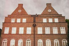 Red brick building facade Stock Images