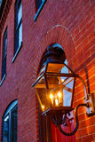 Red brick building facade with light in forground Stock Image