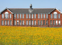 Red brick building in field Royalty Free Stock Photos
