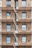Red brick building with fire stairs Stock Images