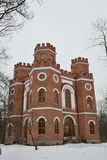 Red brick building with four towers Royalty Free Stock Photography