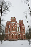 Red brick building with four towers Stock Images