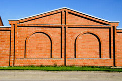 Red Brick Building Wall With Decorations. Stock Photo
