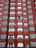 Red Brick Building With White Windows Royalty Free Stock Image