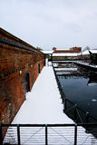 Red brick canal with snow bridge Royalty Free Stock Images