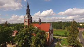 Red brick church in polish village #2 stock footage