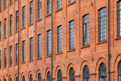 Free Red Brick Classic Industrial Building Facade With Multiple Windows Background. Stock Images - 193822534