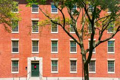 College dormitory. Red brick college dormitory with trees royalty free stock image