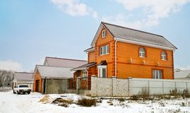 Red brick cottage. In winter Royalty Free Stock Photography