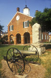 Red brick courthouse with cannon in foreground, Fairfax County, VA royalty free stock photos