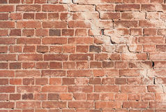 Red brick with a crack background Royalty Free Stock Image