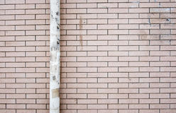Red brick with dirty pipe wall ,Texture background Royalty Free Stock Photos