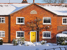 Red Brick English Rural Cottage in the Snow Royalty Free Stock Images