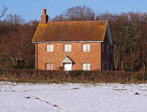 Red Brick English Rural Cottage in the Snow Stock Photos
