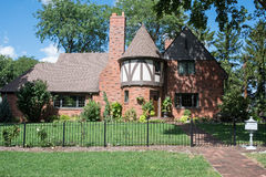 Red Brick English Tudor House with Round Turret Royalty Free Stock Photography